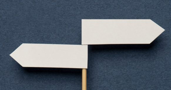 a placard with two opposing direction markers